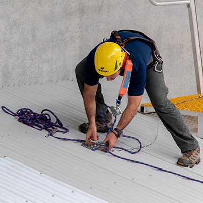 Using an anchor point to provide fall protection while working on a roof.