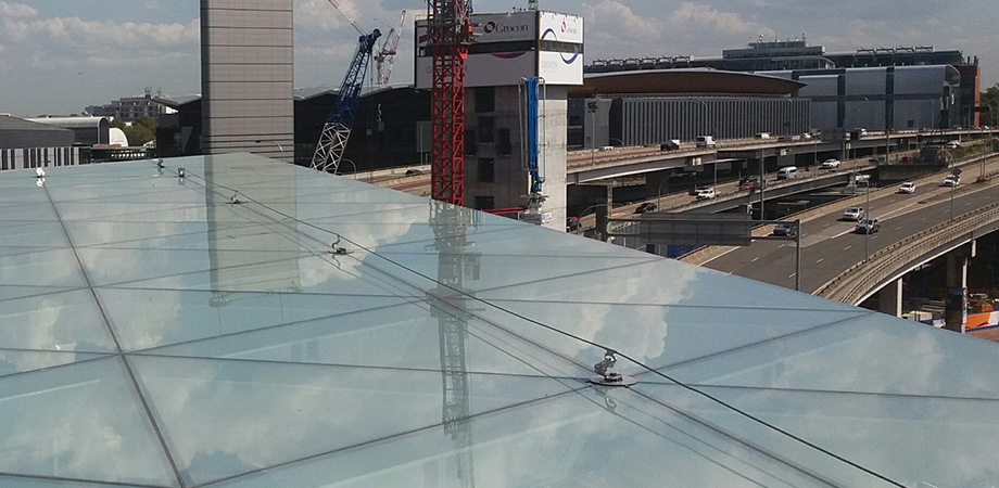 Static line strung along the edge of a glass roof.