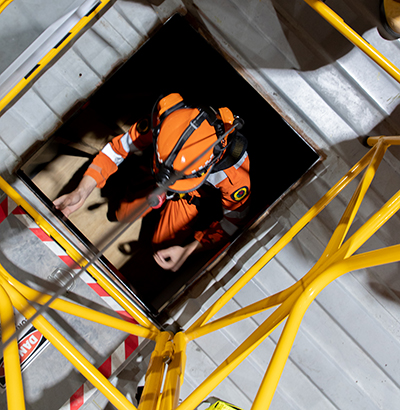Entering a confined space in a simulated emergency.