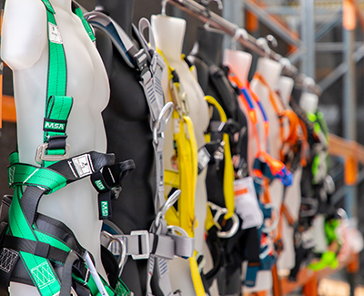 Fall arrest harnesses on display at the HSE PPE showroom in Sydney.