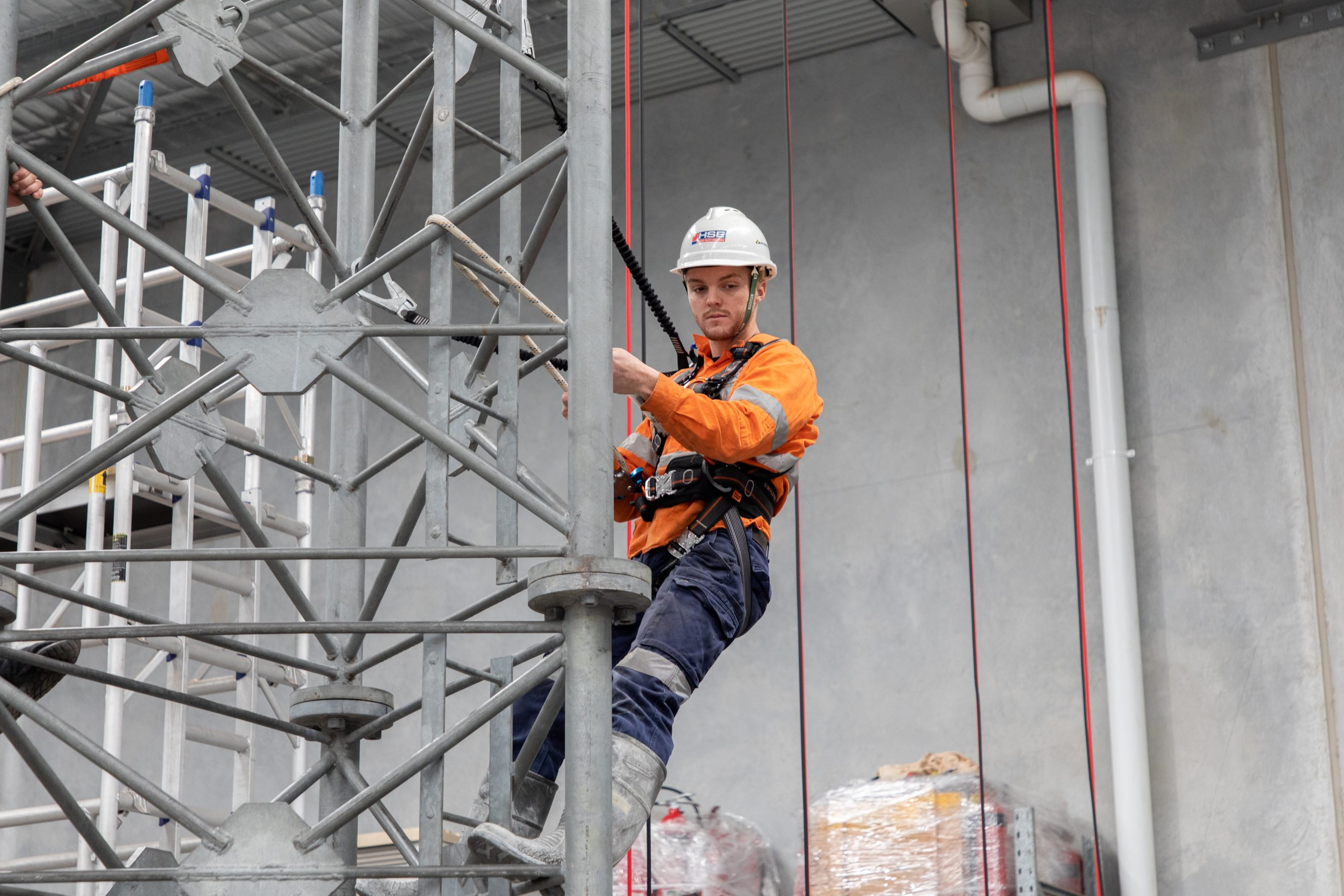 Student using a fall arrest harness while undertaking training at HSE.