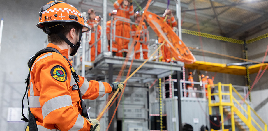 Participant in a height safety course using advanced roof access equipment