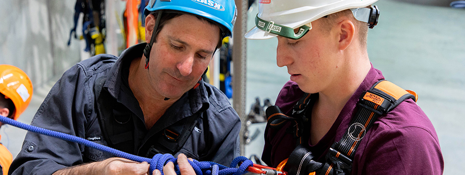 Participant being shown how to tie a particular style of knot during technical rescue training at Height Safety Engineers.