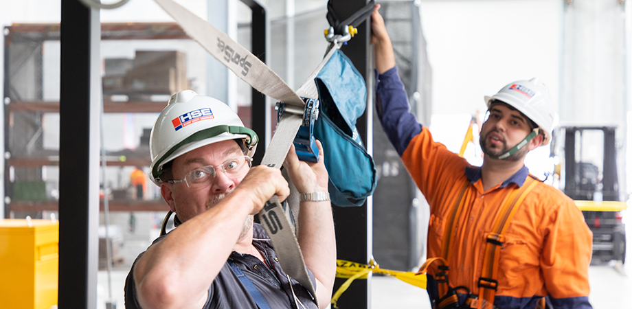 Two participants setting up a temporary static line safety system during work safely at heights training at Height Safety Engineers.
